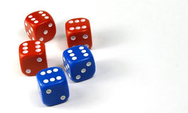 Red and blue dice. Two blue dices and three red dices on a white background stock image