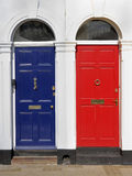 Red and blue doors with white surrounds Stock Image