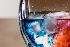 Red and blue dye in liquid stock photos