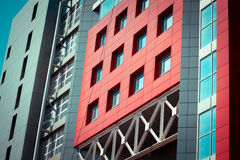 Red-blue facade of urban buildings. On a bright sunny day with blue sky Royalty Free Stock Image