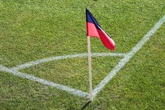 A red and blue flag at one corner of football stadium vector illustration