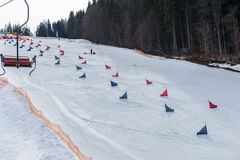 Red and blue flags on ski descents during competitions in winter. Period in a ski-resort Royalty Free Stock Photography