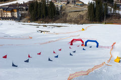 Red and blue flags on ski descents near the finish line. During competitions in winter period Stock Images