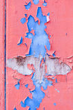 Red and blue flaked paint on wooden door. Red and blue old flaked paint on wooden door Stock Photography