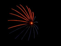 Red blue flare - fireworks. A red and blue firework explodes in the sky with a flash burst in the center Royalty Free Stock Images