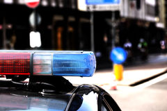 Red and blue flashing lights of the police car in the checkpoint. At night Stock Image