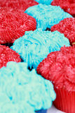 Red and Blue Frosted Cupcakes Stock Images