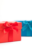 Red and blue gift boxes over a white background Stock Photo