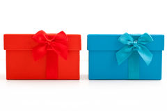 Red and blue gifts with bows Stock Photos