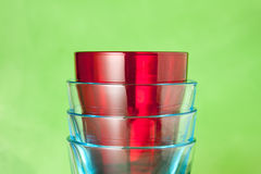 Red and blue glasses on a green background Stock Photo