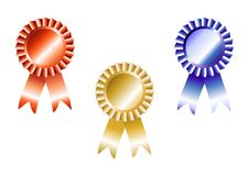 Red, blue and gold rosettes Stock Images