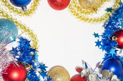 Multicolored Christmas balls with tinsel on a white background. Red, blue, golden Christmas balls with multi-colored tinsel on a white background Stock Photography