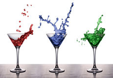 Red Blue Green. Three cocktails in Martini glasses on the table Stock Photos