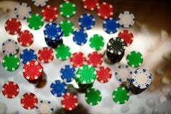 Red, blue, green and black casino tokens Royalty Free Stock Photos