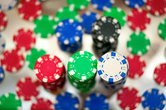 Red, blue, green and black casino tokens Stock Photos