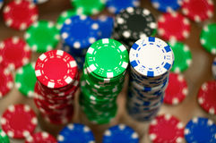 Red, blue, green and black casino tokens Royalty Free Stock Photography