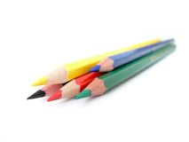 Red, blue, green, black, yellow pencils Stock Photos
