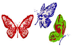 Red, blue and green butterflies made of paint Royalty Free Stock Image
