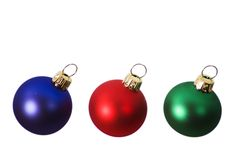 Red, Blue and Green Christmas Bulbs Royalty Free Stock Images