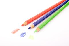 Red, blue and green pencils. With drawings on white background Stock Images