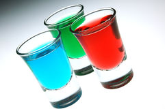 Red blue and green shot. Strawberry peppermint and mint shots in a triangle Royalty Free Stock Images