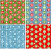 Red, blue and green wallpapers with hanging baubles for winter holidays Stock Photos