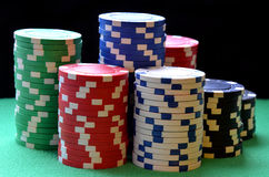 Red, blue, green, white and black poker chips Stock Photos