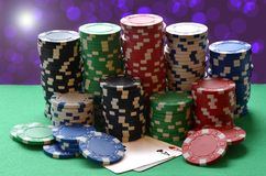 Red, blue, green, white and black poker chips pile and aces Stock Photography