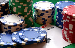 Red, blue, green, white and black poker chips pile and aces Stock Image