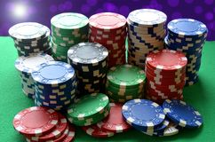 Red, blue, green, white and black poker chips pile Royalty Free Stock Image