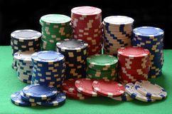 Red, blue, green, white and black poker chips pile Stock Photos