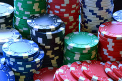 Red, blue, green, white and black poker chips pile Stock Image
