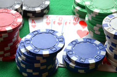 Red, blue, green, white and black poker chips and royal flush Royalty Free Stock Images