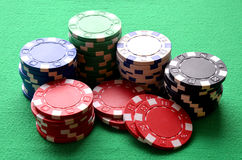Red, blue, green, white and black poker chips Royalty Free Stock Photos
