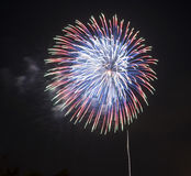 Red, Blue, Green, and White Fireworks. Against a black night sky Stock Photo
