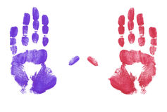 Red and blue hand prints. Red and blue finger painted hand prints Stock Photo