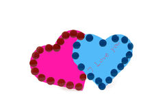 Red and blue heards. With drawing-pins as symbols of love Royalty Free Stock Photos