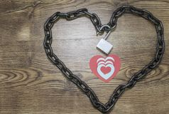 Red, blue heart cards inside the chained heart. stock photography
