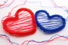 Red and blue hearts of the thread Royalty Free Stock Photography