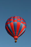 Red and blue hot air balloon. Against a clear blue sky Royalty Free Stock Image