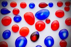 Red and blue  ink drops Royalty Free Stock Photography