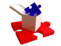 Red and Blue Jigsaw Puzzles with White Box Stock Photo