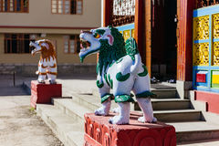 Red and blue kirins in front of Tibetan Buddhism Temple entrance in Sikkim, India stock image