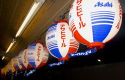 Red and Blue Lanterns in Japan. Red, white, and blue lanterns advertising for Asahi beer in Asakusa district, Tokyo, Japan, showing a beautiful side of lantern Royalty Free Stock Photography