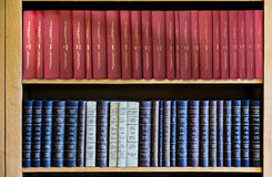 Red and Blue Law Books in Bookshelf Stock Photo