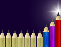 Red, Blue and Lilac Pencils Stands out from the Yellow Ones. Leadership, Winner, Successful Concept. Stock Photo