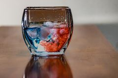 Red and blue liquid stock image