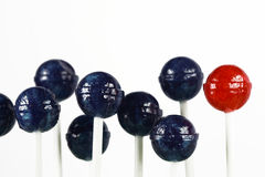 Red and blue lollipops Stock Photos