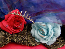 Red and blue love. Paper roses from blue and red color with coloured textiles and diamond bit Stock Photo