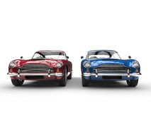 Red and blue metallic vintage cars - front view Royalty Free Stock Photos